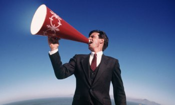 A man shouting through a megaphone
